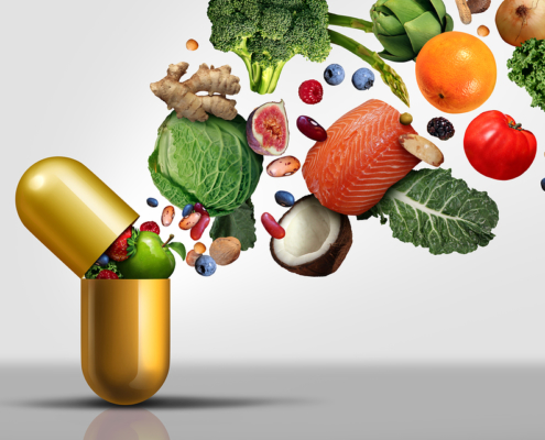 vitamins and healthy foods spilling out of a capsule