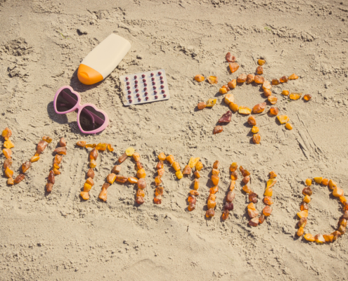 Vitamin D written in sand