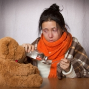 woman, ill, with teddy bear and medicine