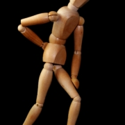 wooden figure model with back pain