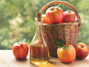 Apple cider vinegar in bottle with apples