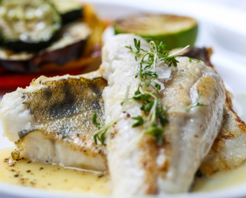 healthy fish on a dinner plate