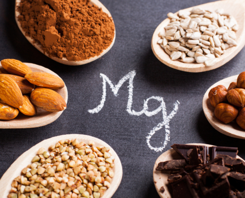 foods rich in magnesium on wooden spoons.