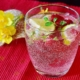 glass of sparkling water with berries