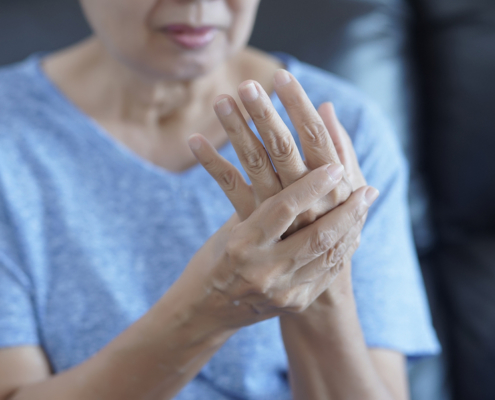 woman suffering from arthritis pain in her hand