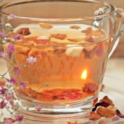 glass tea mug filled with golden herbal tea