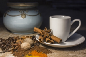 Cinnamon sticks, tea pot and tea cup
