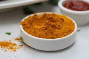 turmeric powder in white bowl