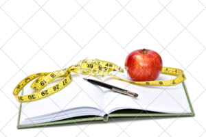 diet diary with apple and tape measure