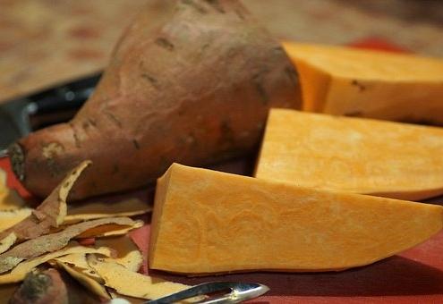 sweet potato sliced on cutting board