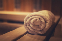 sauna, bath towel on wooden seat